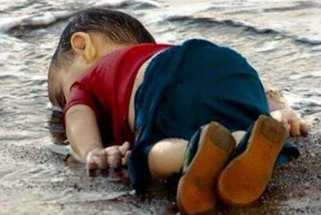 http://cdn.popdust.com/wp-content/uploads/2015/09/Dead-Syrian-Boy-Turkish-Beach-Photo_2015-09-03_23-15-25.jpg